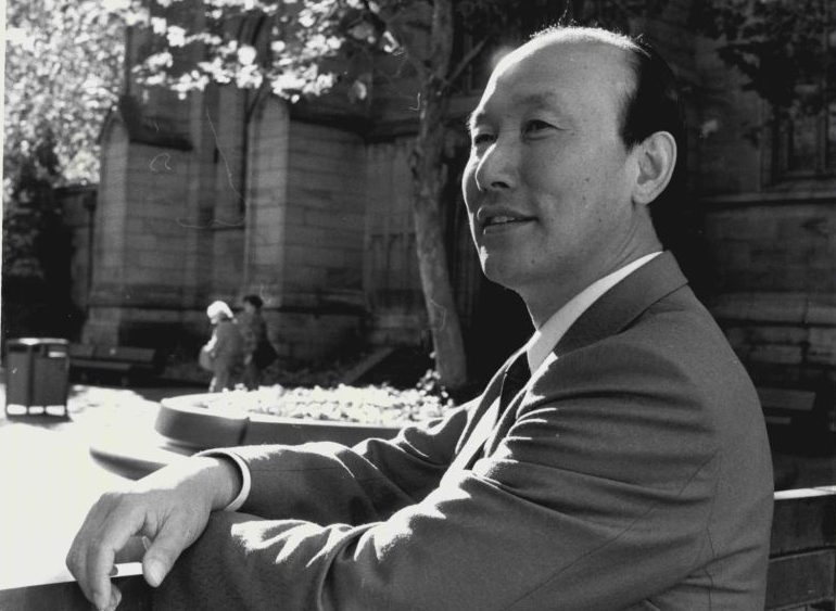 Portraits of Pastor Yonggi Cho, Korean Pentecostal Minister Visiting Sydney. Pictured in Sydney Square, near St Andrew's Church.